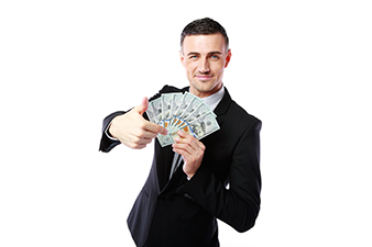 man in a suit, holding out money